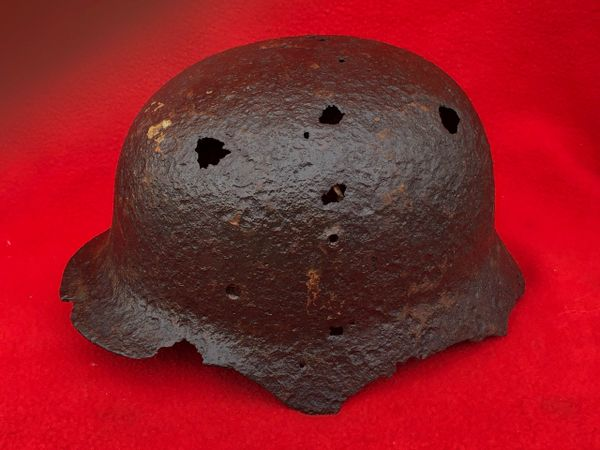 German soldiers M40 helmet with single decal and green paint remains,leather liner remains recovered from near the village of Plota which is south Prokhorovka ware the main tank battle was on the 12th July 1943,Russia