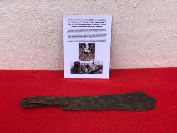 German soldiers machete recovered in December 2019 with picture of recovery from the area of Priekule in the Kurland pocket defended by the SS Nordland Division during the battle in 1944-1945 in Latvia