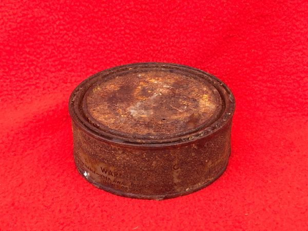 American soldiers shoe cleaning tin still full with contents,original markings with paper stuck on the base recovered from the Woods around Bastogne in, Ardennes Forest 1944-1945