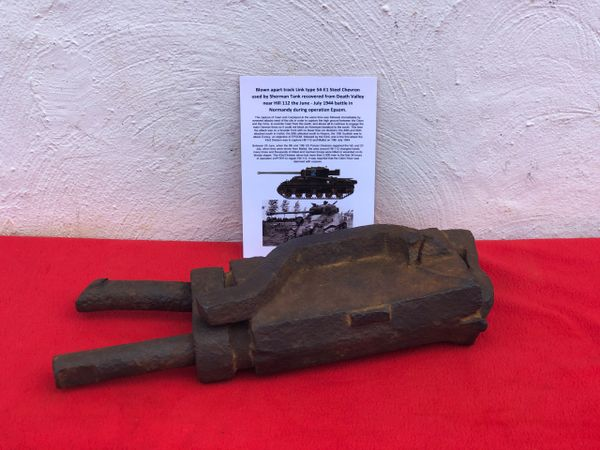 Battle damaged track Link type 54-E1 Steel Chevron used by a Sherman tank recovered from death valley near Hill 112 fought 26-30 June 1944 during Operation Epsom in Normandy