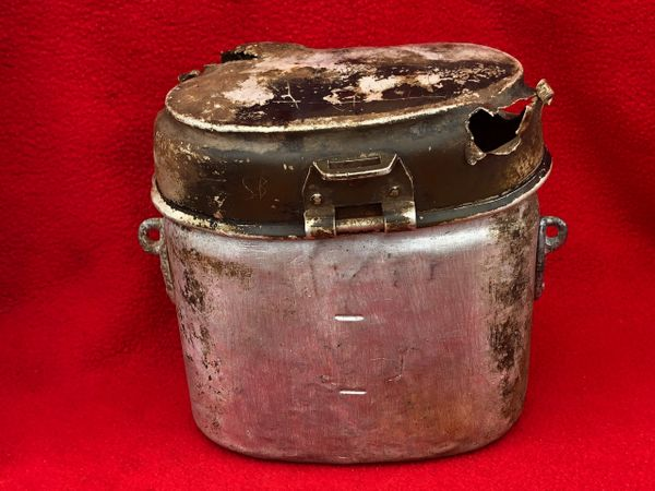 German aluminium mess tin dated 1941 with soldiers scratched initials on and the lid is battle damaged used by soldier of the 77th Infantry Division recovered Mairle de Pleurtuit the battle for St malo port in August 1944,Normandy