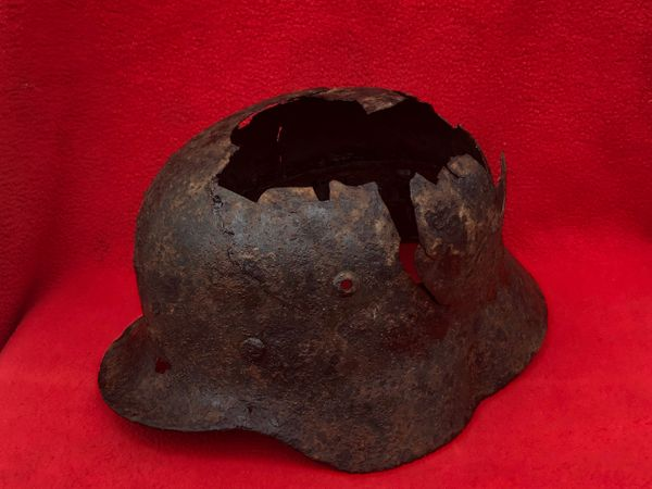 Rare early war German soldiers double decal M35 helmet,paintwork and decal remains,named inside,battle damaged recovered from Narvik area in Norway the land battle that was fought in April-May 1940