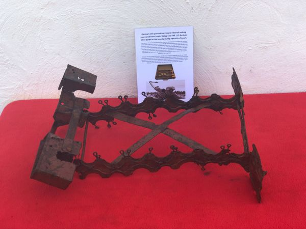 German stick grenade carry case internal rack,relic solid condition,red paintwork recovered from Death Valley near Hill 112 the battle in operation Epsom on the Normandy battlefield of 1944