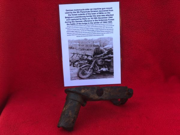 German motorcycle side car machine gun mount with white camouflage paintwork remains used by the 5th Parachute Division recovered in the forest outside Wiltz on the Belgium-Luxembourg border in the Ardennes Forest battle of the bulge 1944-1945