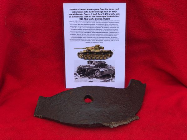 Section of 10mm armour plate from the turret roof with impact hole, battle damaged from German Panzer 3 Tank Ausf A-C recovered from the site of destroyed tank in Sevastopol the battlefield of the Crimea 1941-1942 in Russia