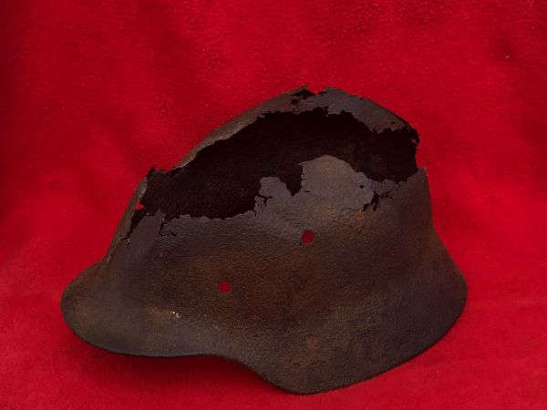 German M40 steel helmet, damaged with some small amount of green paintwork remains used by soldier of the 708th Volksgrenadier Division recovered near Mackenheim in the Culmar Pocket of early 1945 in France