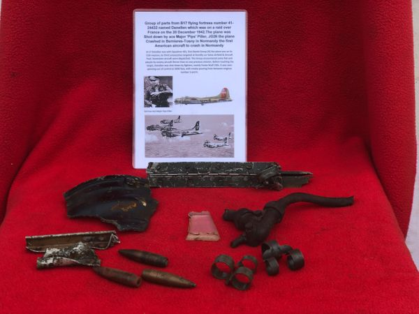 Group of airframe, engine parts with 50 cal ammunition heads and clips from American B17 flying fortress number 41-24432 named Danellen which was on a raid over France on the 20 December 1942