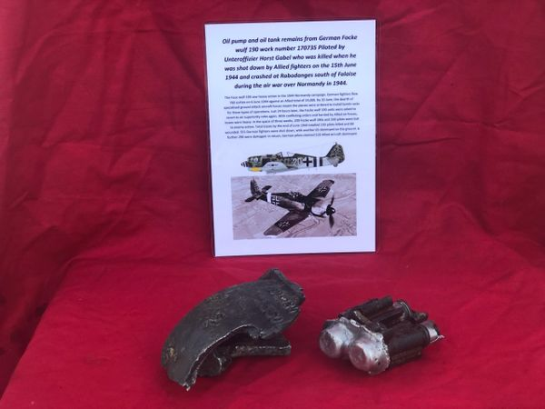 Oil pump and oil tank section with black paintwork maker marked lovely clean condition from German Focke wulf 190 number 170735 shot down by Allied fighters on the 15th June 1944 over Normandy it crashed near Falaise