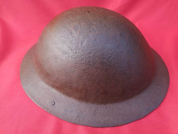 British soldiers world war 1 brodie helmet 1917 pattern missing rim re used in world war 2 on the home front for civil defence with black paint work remains found in house clearance in Blackheath in London properly used during the Blitz