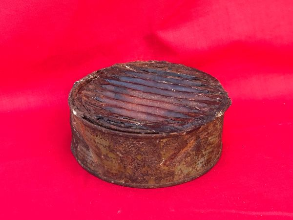American soldiers shoe tin polish complete with all contents and some maker markings still clear to see it was recovered in the woods around Bastogne from the Siege in the battle of the Bulge 1944