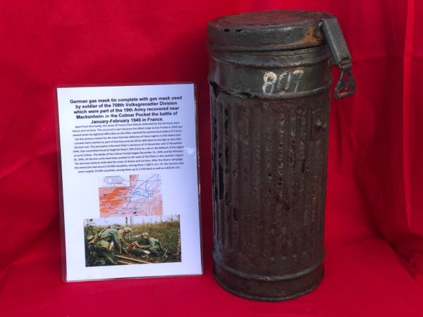German gas mask tin complete with gas mask, with soldbuch number on the side used by soldier of the 708th Volksgrenadier Division recovered near Mackenheim in the Culmar Pocket of early 1945 in France
