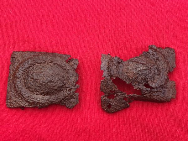 Pair of German Luftwaffe belt buckles with eagle and swastika remains, nice relic recovered from a field near the village of Trun in the Falaise Pocket in Normandy 1944 summer battlefield