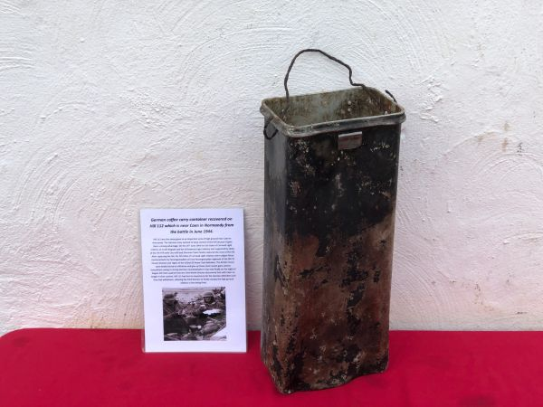 German coffee carry container aluminium made, black paint work remains recovered on Hill 112 the battle in operation Epsom on the Normandy battlefield of 1944
