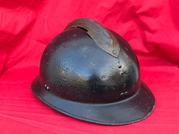 Belgium Army M26 Adrian helmet over painted black for civil defence found in Bruges from the battle of Belgium the May in 1940