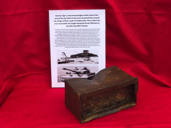 Battle damaged armoured glass vision block from around the top hatch in the turret from German Tiger tank recovered from Plota, near Prokhorovka on the battlefield at Kursk in Russia
