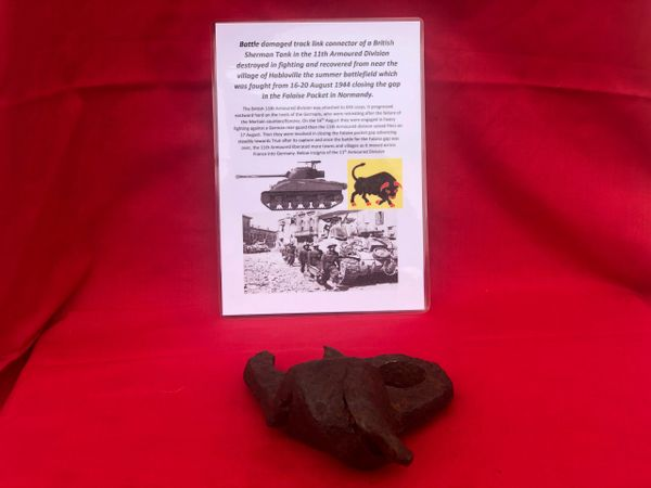 Battle damaged track link connector from British Sherman Tank,11th Armoured Division destroyed in fighting and recovered from near the village of Habloville the battle of the 16-20 August 1944 in the Falaise Pocket in Normandy