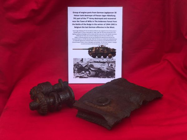 Group of engine parts cogged shaft,bolt and large section of engine case from German Jagdpanzer 38 Hetzer tank destroyer from panzer Jager Abteilung 741 in the 7th Army destroyed in December 1944 near the town of Wiltz in the Ardennes Forest