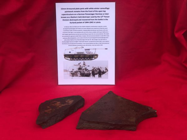 2 Sections of 15 mm armoured plate with lots of paint remains, original colour the front of the open top superstructure from a German Nashorn tank destroyer used by the 12th Panzer Division recovered in the Kurland Pocket 1944-1945 battle in Latvia