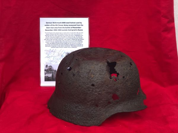 German soldier of the 4th Panzer Army M40 steel helmet, solid relic condition with battle damage with green paintwork remains recovered on the Dom river area from the battles of November- December 1942 outside Stalingrad