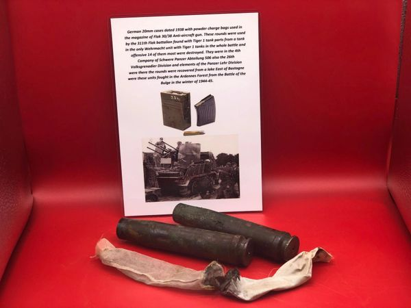 2 X German 20mm brass cases with powder charge bags dated 1938-1939 for Flak 30/38 Anti-Aircraft gun belonging to Luftwaffe 311th Flak battalion recovered from a Lake East of Bastogne from battle of the Bulge 1944-1945