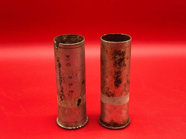 Pair of German small flare cases one maker marked dated September 1944 both white stripe used by the German 212 Volksgrenadier-Division recovered near town of osweiler, Luxemburg from the battle of the Bulge 1944-1945