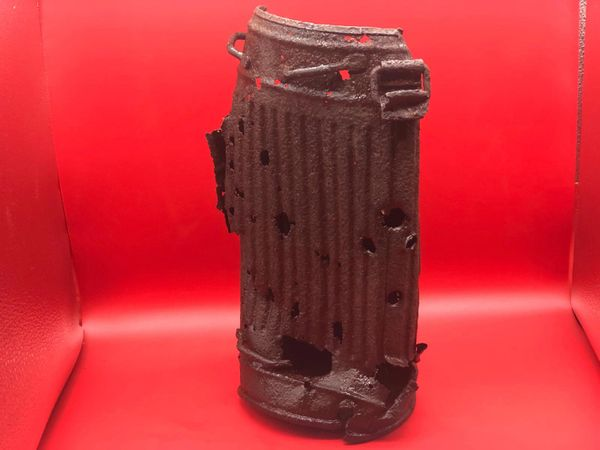 German soldiers gas mask tin relic condition with battle damage impact holes recovered from Death Valley near Hill 112 the battle during operation Epsom in June 1944 on the Normandy battlefield
