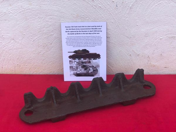 Track link ice cleat with lots of green paint remains a nice relic condition, well cleaned from a destroyed Russian T34 tank of the 3rd Shock Army recovered from Wandlitz near Berlin the April 1945 battle for the city