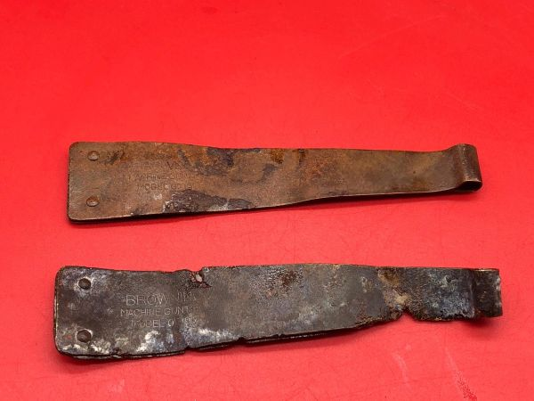Pair of American Browning machine gun ammunition belt starter tabs ,bent up a bit damaged, brass colour with markings recovered from the Meuse Argonne Forest the 1918 battlefield