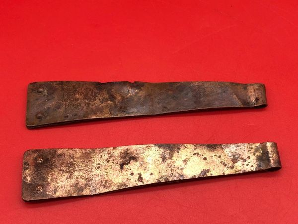 Pair of American Browning machine gun ammunition belt starter tabs ,bent up, brass colour with all there original markings recovered from the Meuse Argonne Forest the 1918 battlefield