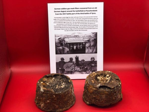 Pair of German gas mask filters in relic as found condition recovered from an old German dugout around the battlefield at Passchendaele from the 1917 battle part of the third battle of Ypres.