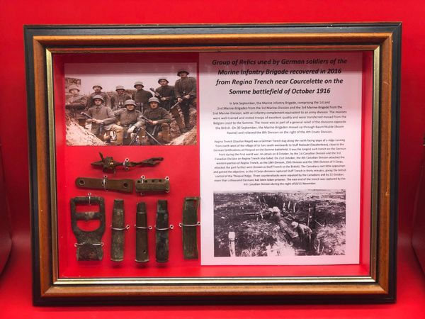 Glass framed relics used by German soldiers of the Marine Infantry Brigade and a British bullet case all recovered in 2016 from ,Regina Trench near the village of Courcelette on the Somme battlefield of October 1916