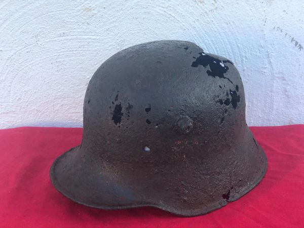 M18 steel helmet re issue belonging to German soldier of the Pazer Lehr Division with paintwork ,decal remains and liner remains recovered in the area of the Longvilly road near Bastogne in the Ardennes Forest from battle of the Bulge 1944-1945