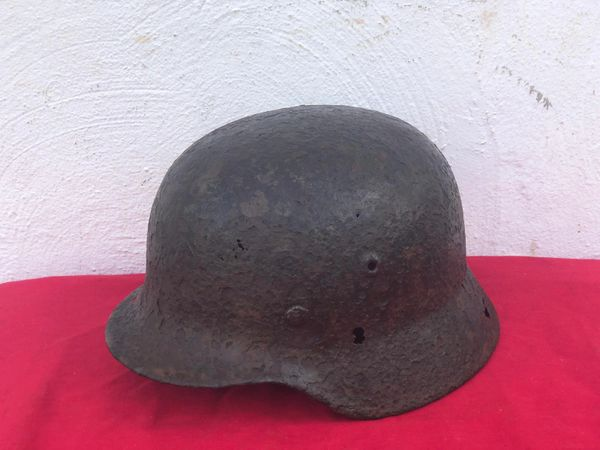 German soldiers M40 helmet with original green paintwork and a very nice relic recovered from Monte Cassino the Italian battlefield of 1944 from a local museum which closed down in 2015