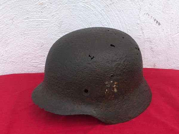 Very rare German soldiers double decal M40 helmet with original green paintwork and late war overpainted decals and a very nice relic recovered from Monte Cassino the Italian battlefield of 1944 from a local museum which closed down in 2015