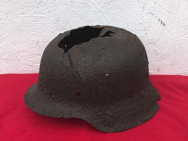 German M42 helmet with green paint remains, battle damaged used by soldier of Panzer Grenadier Division Kurmark, relic condition recovered in Carzig south of the Seelow heights the 16-19 April 1945 battlefield
