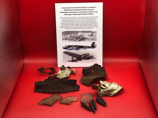 Group of airframe parts with paintwork, cockpit perspex burnt and 7.92mm bullet heads from German Heinkel 111 bomber shot down on the 16th August 1940 and crashed at Northchapel during the battle of the Britain