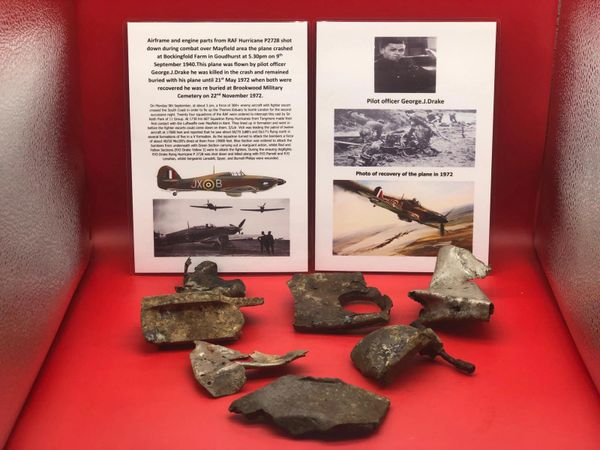 Airframe sections and engine parts with paintwork remains from RAF Hurricane P2728 shot down during combat over Kent and crashed in Goudhurst on the 9th September 1940 during the battle of Britain.