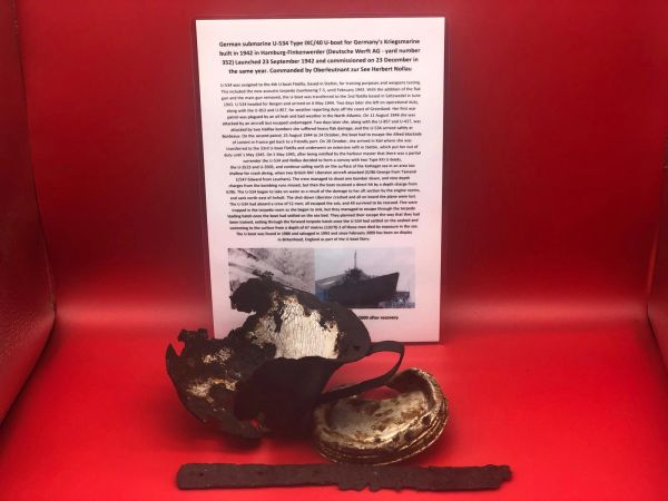 Drinking cup, knife and tin lid with impact damage recovered from U-Boat U534 which was sunk on the 5th May 1945 by RAF Bombers