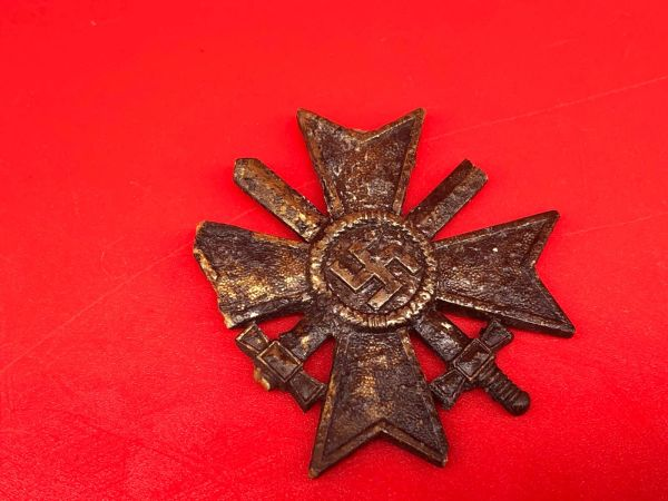 Rare battlefield find a German complete War Merit cross with swords medal in bronze lovely condition relic with original colour and markings recovered in the Demyansk Pocket near Leningrad in Russia