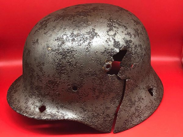 German soldiers M40 helmet with impact hole battle damage very well cleaned smooth to the touch relic recovered in the area of Aachen in Germany from the September-October 1944 battle to capture the city.