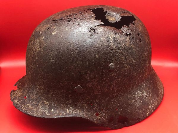 German soldiers M35 steel helmet very solid relic which has been used post war it is very clean with post war over paint found in the 1970's on Jersey in the channel islands from German occupation 1940-1945