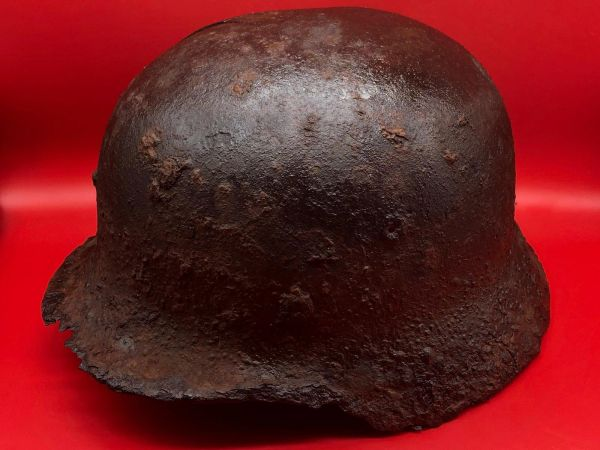 German M40 steel helmet with liner ring, blast crack and some paint remains used by soldier of 212 Volksgrenadier-Division recovered near town of osweiler, Luxemburg from the battle of the Bulge 1944-1945