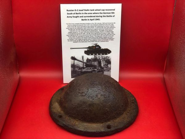Russian IS-2 josef stalin tank wheel cap with green paintwork remains recovered from the site of a destroyed tank which is South of Berlin in the area the German 9th Army fought, surrendered in April 1945 during the battle of Berlin