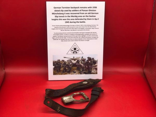Rare German tornister back pack remains a clip dated 1938 also leather straps used by soldier of Panzer Division Muncheberg recovered from an old German Slip trench in the Werbig area, Seelow heights this was the area defended by them in April 1945 battle