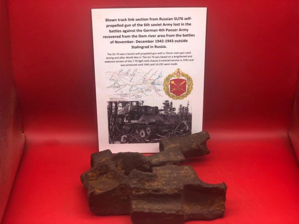 Blown track link section from Russian 6th Soviet Army SU76 self propelled gun which is a nice solid relic recovered on the Dom river the area of the Italian mountain Division defended by them in January 1943 during the battle of Stalingrad