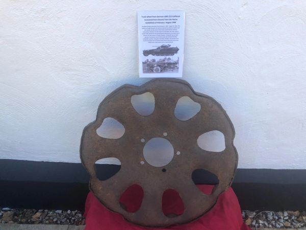 German 251 half track wheel re used post war nice solid relic condition well cleaned some original paintwork recovered in Estonia from the Narva battlefield of February- August 1944 and there were SS and Wehrmacht units involved in the fighting