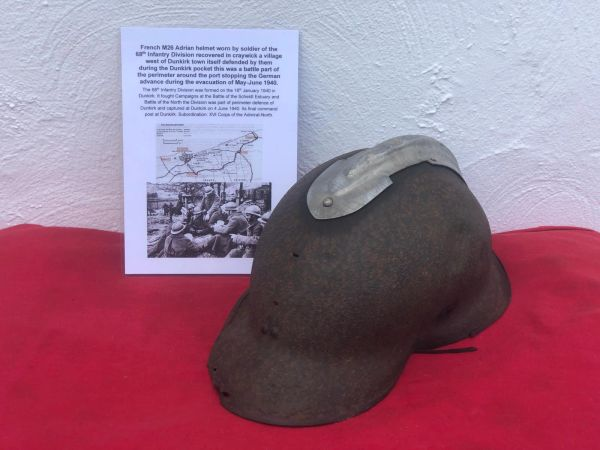 French Army M26 Adrian helmet, battle damaged with no badge worn by a soldier of the 68th Infantry Division recovered in craywick a Village west of Dunkirk defended by them during the evacuation in June 1940