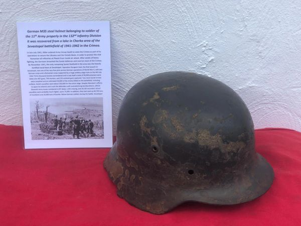 German M35 pattern Helmet fantastic condition relic with lots of original paintwork properly used by soldier of 132nd Infantry Division recovered from a lake in Cherka area of Sevastopol the battlefield in the Crimea 1941- 1942