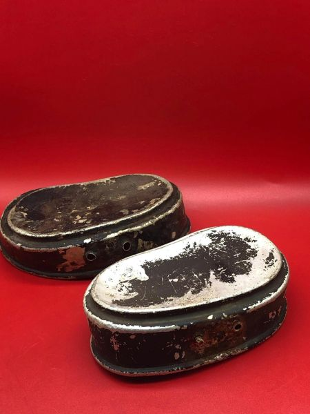 German soldiers aluminium mess tin lids with black paintwork remains used by soldier of the 132nd Infantry Division recovered on the Sevastopol battlefield in the Crimea 1941- 1942