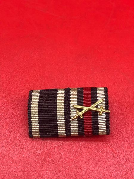 German pair of 2 ribbon bar awards nice used condition uniform removed from German prisoners of war captured it came from the local museum in Monte Cassino the Italian battlefield of 1944 which closed down in 2015